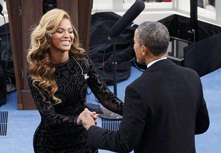 Fotógrafo frances afirmó que el Washington Post tiene las 'indiscreciones' sobre una presunta relación entre el presidente de EU y la cantante. (Agencias)