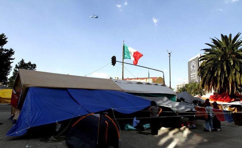 Foto de archivo del plantón reciente en el Monumento a la Revolución por parte de integrantes de la CNTE. (Notimex)