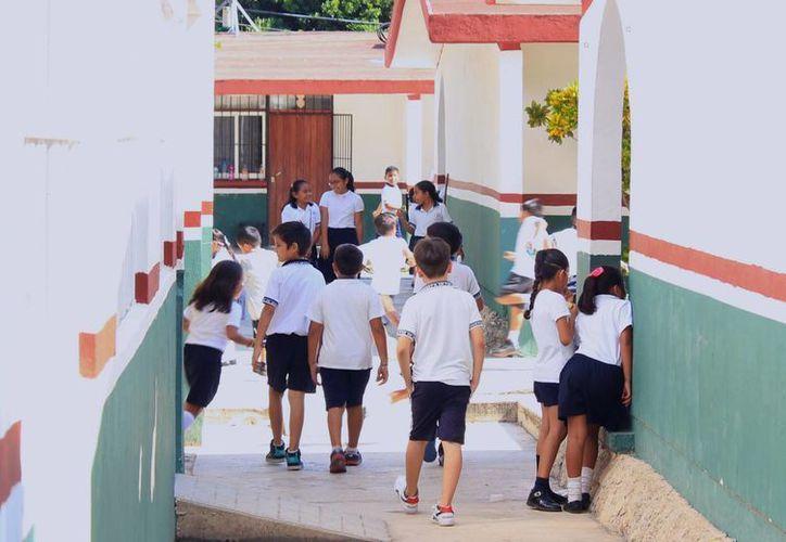 La operación de escuelas de Tiempo Completo será aplicada hasta el próximo ciclo escolar en planteles de Benito Juárez. (Jesús Tijerina/SIPSE)