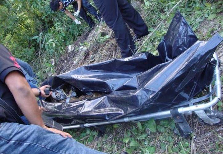 Los cuerpos estaban en una fosa clandestina hecha con rocas. (Archivo/SIPSE)