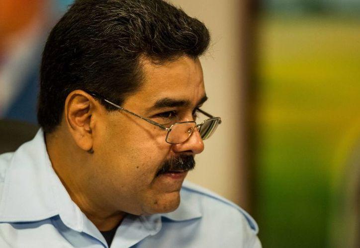 Maduro respaldó públicamente a la mujer, Clotilde Palomino, en una rueda de prensa en Caracas. (Fotos: EFE)