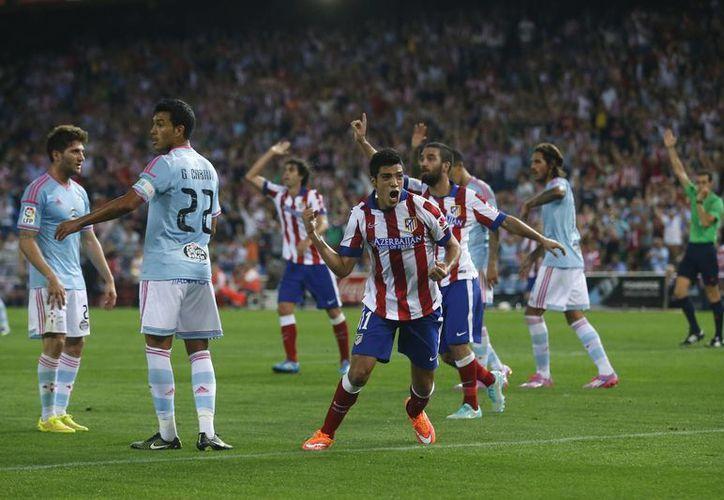 Jiménez regresó a la actividad con los Colchoneros tras lesionarse el tobillo con la Selección de México. (Foto: Archivo/AP)