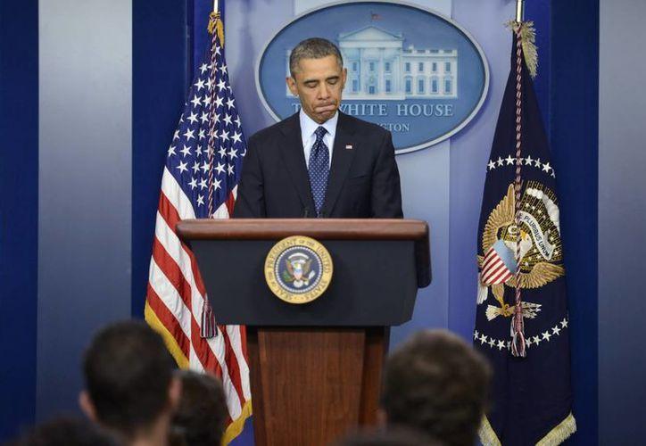 El presidente Obama durante una rueda de prensa en la Casa Blanca, tras la reunión a puerta cerrada con los principales líderes del Congreso. (EFE)