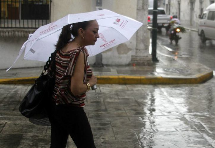 Las lluvias podrían llegar hasta los 150 milímetros este domingo en Yucatán debido a un disturbio meteorológico. (SIPSE)