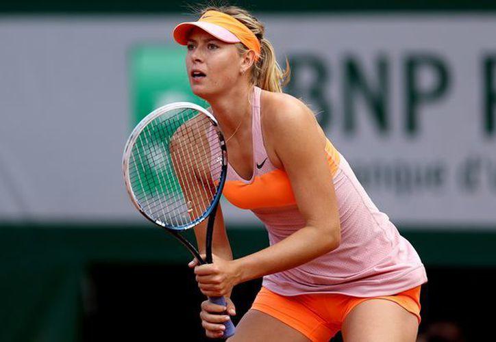 La tenista rusa se enfrentó a  la italiana Roberta Vinci. (Sopitas.).