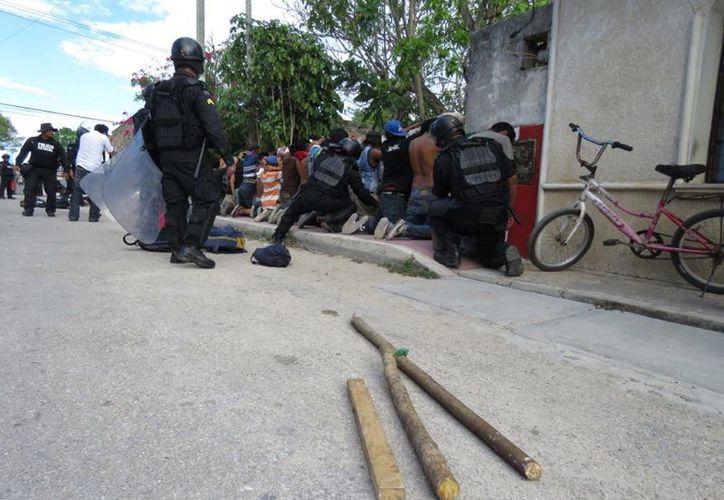 La mortal reyerta en Temax, que dejó como saldo dos pandilleros muertos y varios lesionados, en junio de 2015. (Milenio Novedades)