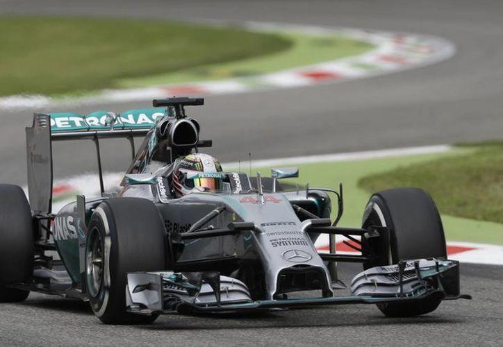 Hamilton cubrió el recorrido de Monza en un minuto, 26 segundos y 187 milésimas, 623 menos que el inglés Jenson Button. (Foto: AP)