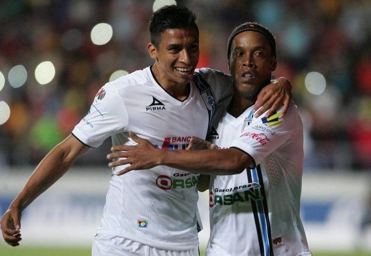 Gallos Blancos, con su estrella Ronaldinho Gaúcho, están en semifinales del Clausura 2015. (Notimex)