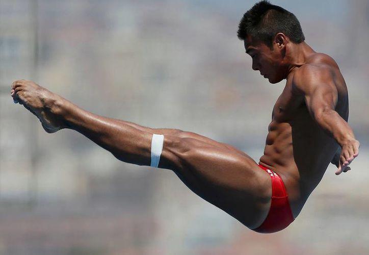 Kevin Chávez representó a México en varias competencias, pero al no competir en dos años, pudo representar a Australia, según reglamentos de la FINA. (EFE)