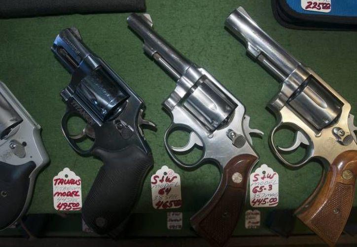 La Sedena informó que el total de licencias de arma de fuego vigentes es de tres mil 140. (EFE/Foto de contexto)