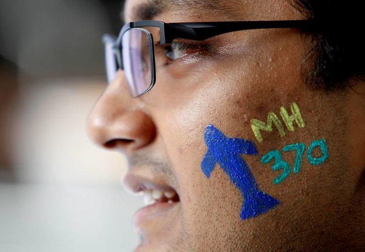 La misteriosa desaparición del vuelo MH-370 de Malaysia Airlines cumple tres años este 8 de marzo. (AP/Daniel Chan)