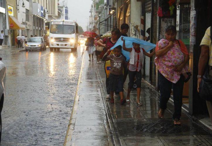 La fuerte precipitación del miércoles tomó por sorpresa a miles de meridanos. (Juan Albornoz/SIPSE)