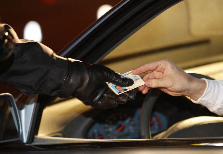 Los inmigrantes solicitantes de la licencia de segundo nivel tendrán que aprobar exámenes escritos y de conducción en Maryland. (Foto de contexto/Agencias)