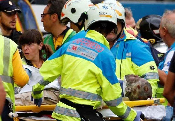 Al menos 11 personas heridas y una muerta fue el saldo del derrumbe de parte del hotel Ritz de Madrid. (Reuters)