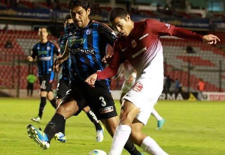 El Morelia, vigente campeón de la Copa MX, se mostró inoperante al ataque y lo pagó caro en su casa ante Querétaro. (mediotiempo.com/Foto de archivo)