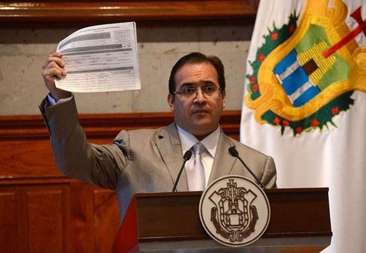 Javier Duarte de Ochoa dijo que su gobierno respetará la decisión de la SCJN. (Excélsior)