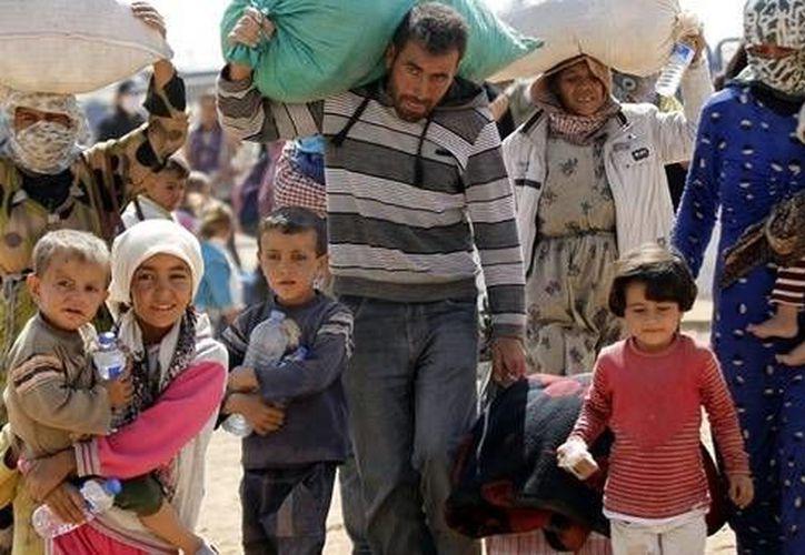 Más de un millón de personas llegaron a Europa en 2015 en la mayor oleada de refugiados en el continente desde la segunda guerra mundial. (AP)
