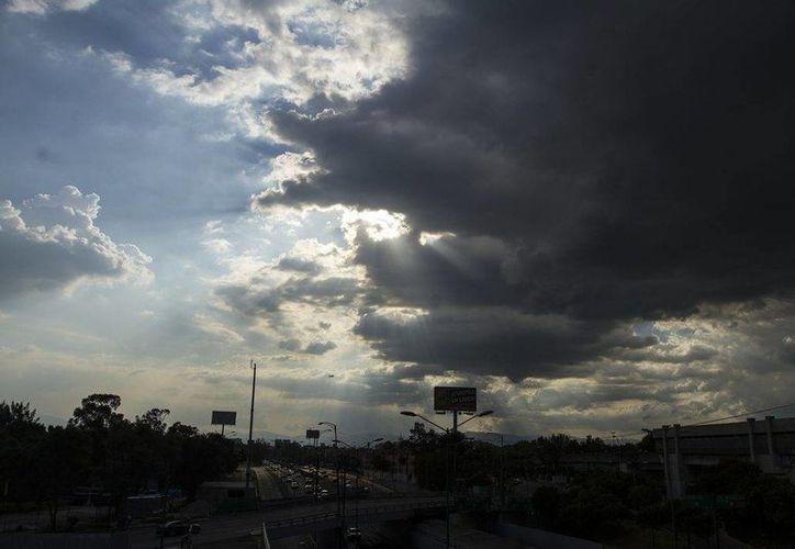 Una zona de inestabilidad en el Golfo de México estará generando lluvias intensas en estados como Hidalgo y Puebla. (Archivo/Notimex)
