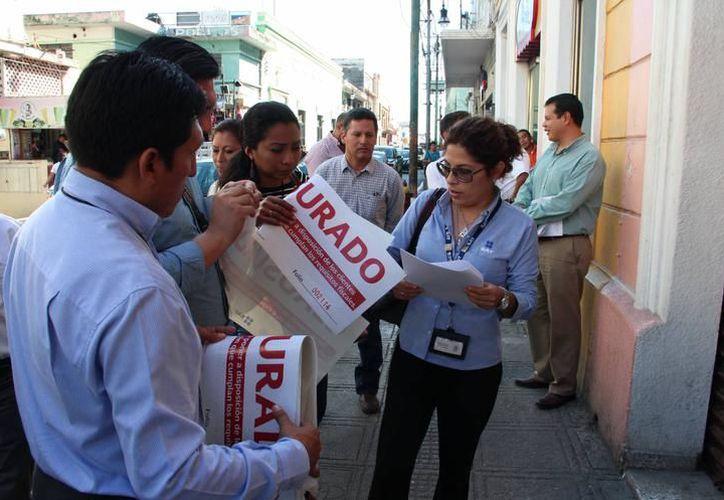 En los últimos cuatro días el Servicio de Administración Tributaria (SAT) procedió a clausurar ocho restaurantes y negocios de comida rápida en la capital yucateca por no extender facturas electrónicas. (Archivo SIPSE)