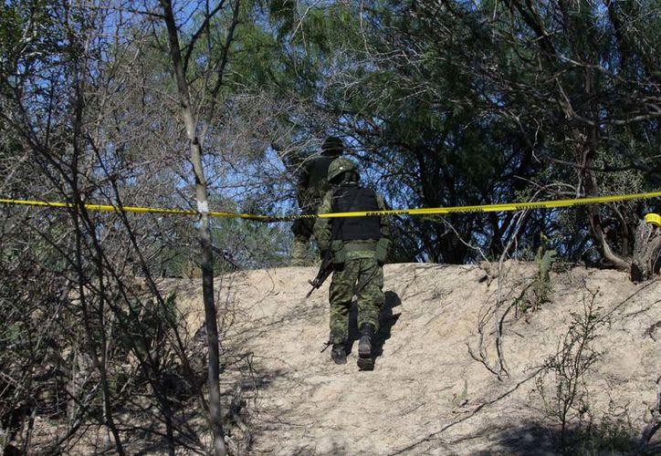 El reporte de la fosa clandestina fue recibido la noche del martes a través del número de emergencia 911. (Proceso).