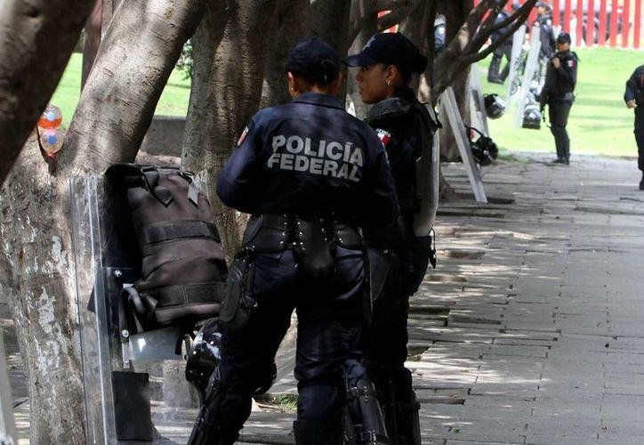 Casi un 90 por ciento de los mexicanos percibe que en la policía es donde se dan más actos de corrupción. (Archivo/SIPSE)