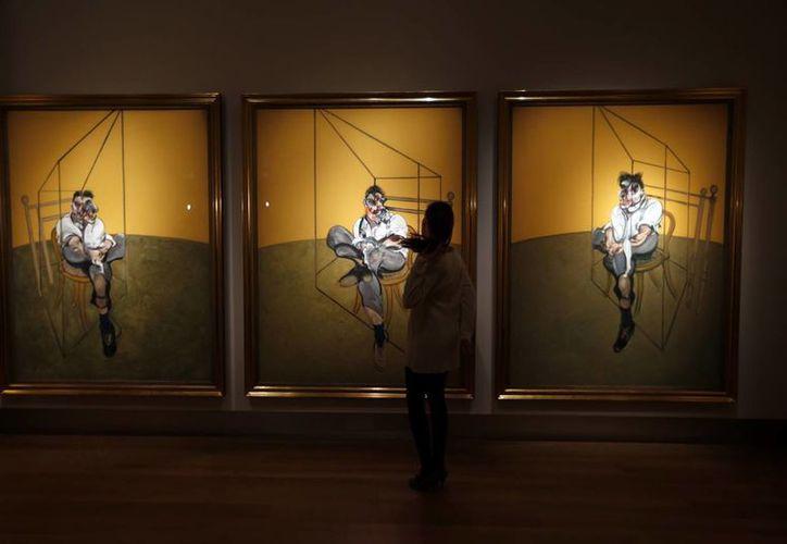 El retrato de tres paneles que Bacon hizo al nieto artista de Sigmund Freud, fallecido en 2011, se creó en 1969 y nunca se ha subastado. (Agencias)