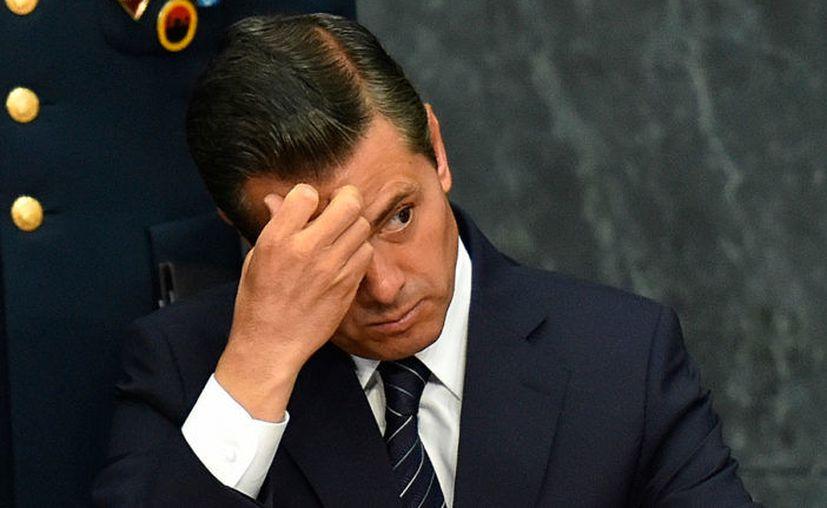 El presidente de México, Enrique Peña Nieto, aseguró que él también se ha sentido espiado. (Proceso)