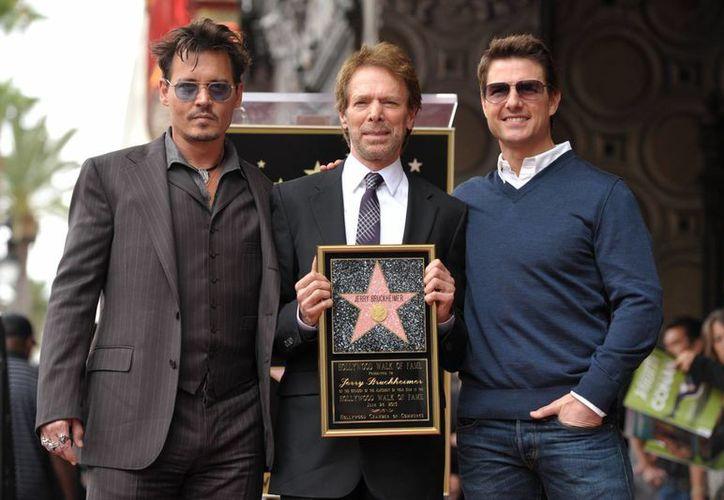 Desde la izquierda: Johnny Depp, Jerry Bruckheimer y Tom Cruise. que han trabajado juntos varias veces. (Agencias)