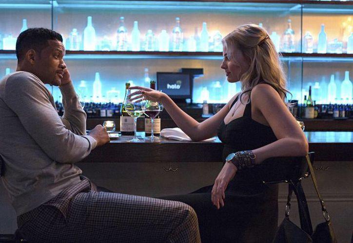 En la cinta 'Focus' el actor Will Smith interpreta a un estafador. (AP)