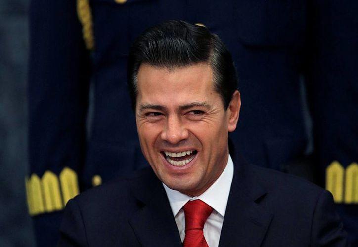 Importantes voces de la política y los negocios llamaron a cerrar filas en torno a Peña Nieto, ante los constantes ataques al país del presidente Trump. (AP/Marco Ugarte)