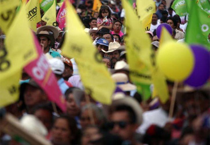 En Tancítaro, uno de los municipios donde se originaron las autodefensas, como medida de protección para los ciudadanos, PAN, PRI y PRD coincidieron que era importante ir juntos. (Excelsior)