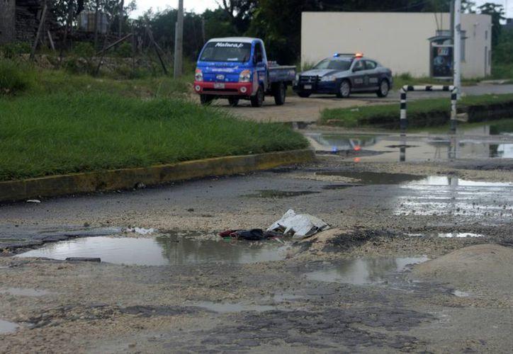El Ayuntamiento capitalino suspendió la semana pasada las obras de bacheo. (Harold Alcocer/SIPSE)