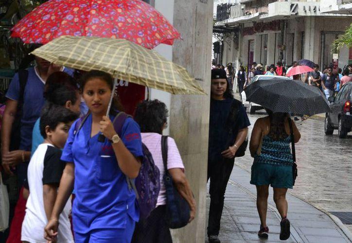 Mérida registró este lunes por la tarde lluvias ligeras y viento moderado. (Milenio Novedades)