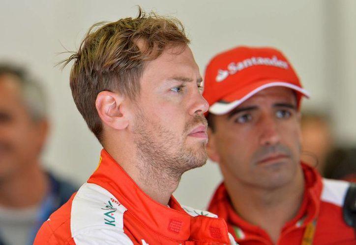 El alemán Sebastian Vettel logró con Ferrari el tiempo más rápido en la segunda sesión de prácticas del Gran Premio de Austria este viernes, pese a pasarse la mayor parte de la jornada (foto) en el taller. (AP)