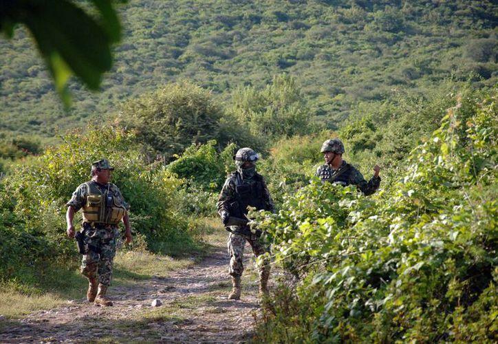 El procurador de Guerrero indicó que los detenidos por los hechos en Iguala fueron quienes revelaron la ubicación de las fosas clandestinas. (AP)