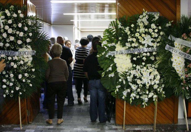 La misa se realizó en la sala 5 del velatorio Bosques del Recuerdo. (Notimex)