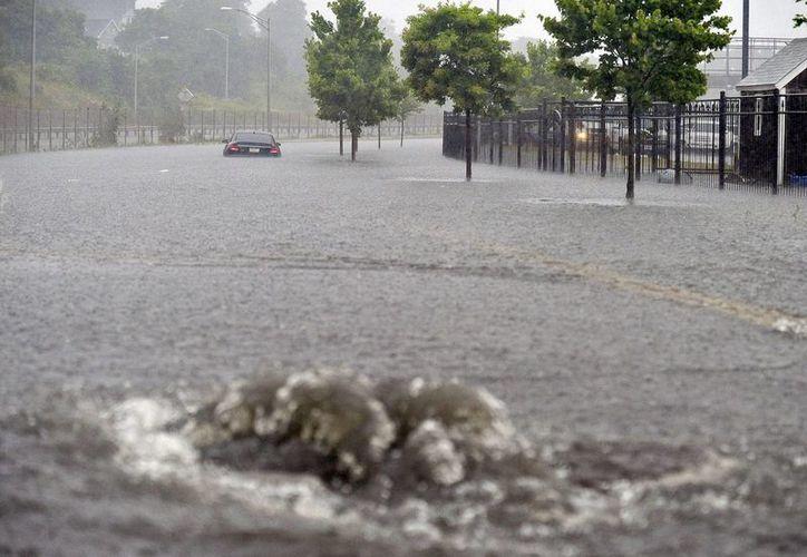 Arthur provocó inundaciones en New Bedford, Massachusetts. (Fotos: AP)