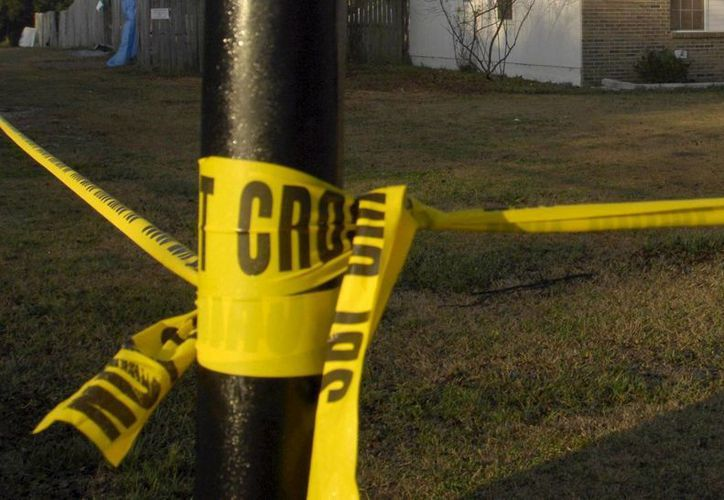 En el lugar fueron encontrados los cadáveres de una mujer y un adolescente. (EFE)