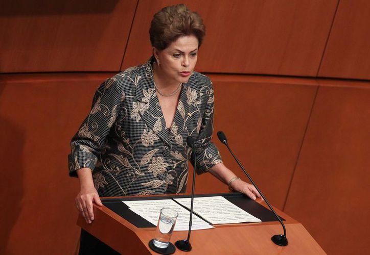El proceso de juicio político contra la presidenta Dilma Rousseff podría reanudarse hasta 2016, debido al receso del Congreso. (EFE)