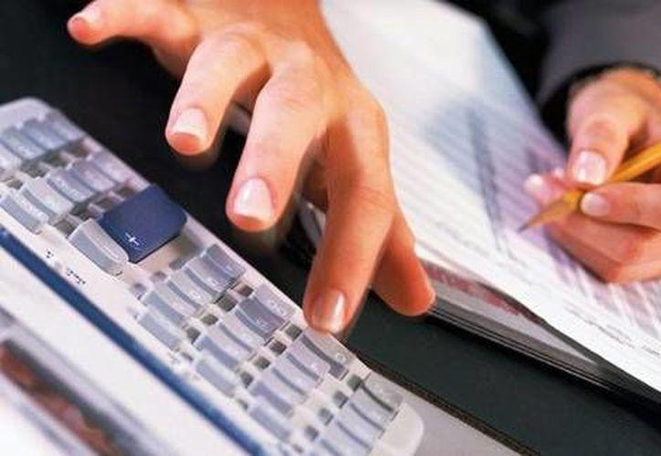 En el curso de la Universidad Tecnológica de Cancún se enseñará a realizar el pago de impuestos como personas físicas. (Redacción/SIPSE)