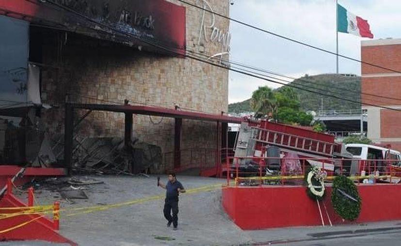 El Casino Royale ardió en llamas con personas en su interior el 20 de agosto del 2011. (Archivo/Notimex)