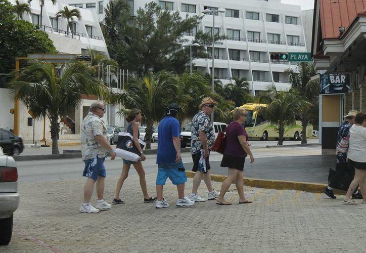 Agilizar los trámites migratorios aumentaría la afluencia turística en este destino. (Jesús Tijerina/SIPSE)