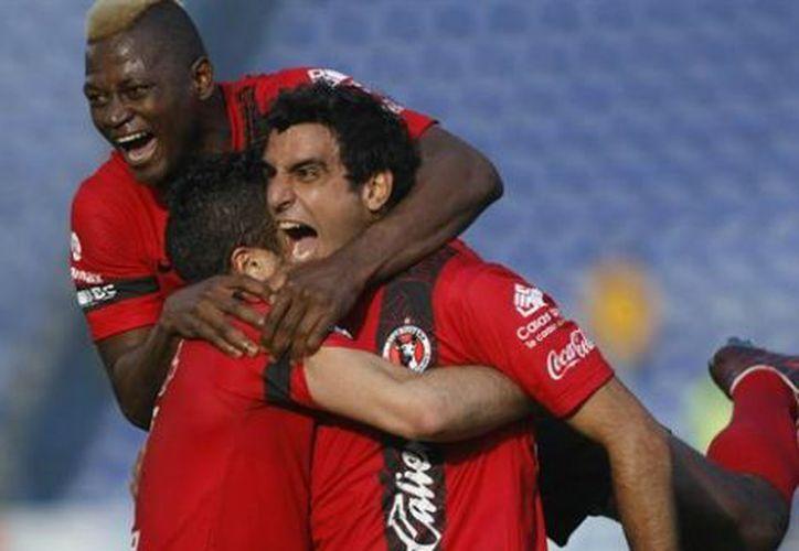 Xolos consigue su primer triunfo del Torneo Clausura 2013. (EFE)