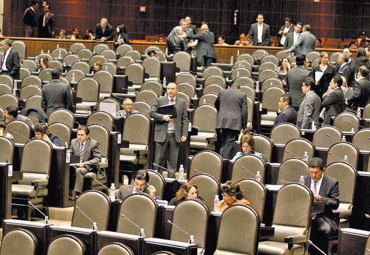 El debate legislativo de este martes en San Lázaro, donde aprobaron aumentar el castigo a terroristas y a quienes tomen rehenes. (Octavio Hoyos/Milenio)