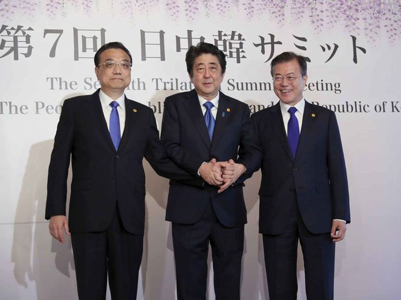 Chinese Premier Li Keqiang, left, Japanese Prime Minister Shinzo Abe, center, and South Korean President Moon Jae-in, right.