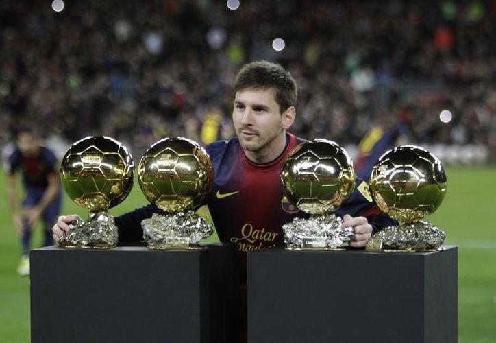 A sus 25 años de edad Lionel Messi  ya ganó cuatro premios Balón de Oro. (Agencias)