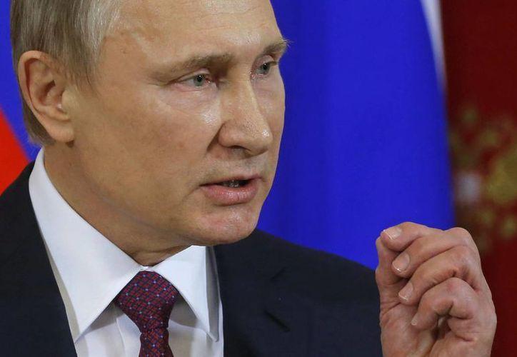 Vladimir Putin asegura que el fenómeno de la prostitución en Rusia es 'lamentable'. (Sergei Ilnitsky/Pool Photo via AP)
