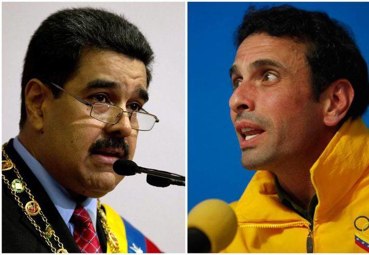 Henrique Capriles (der.) insiste en realizar un referendo revocatorio de mandato del presidente Nicolás Maduro. (AP)