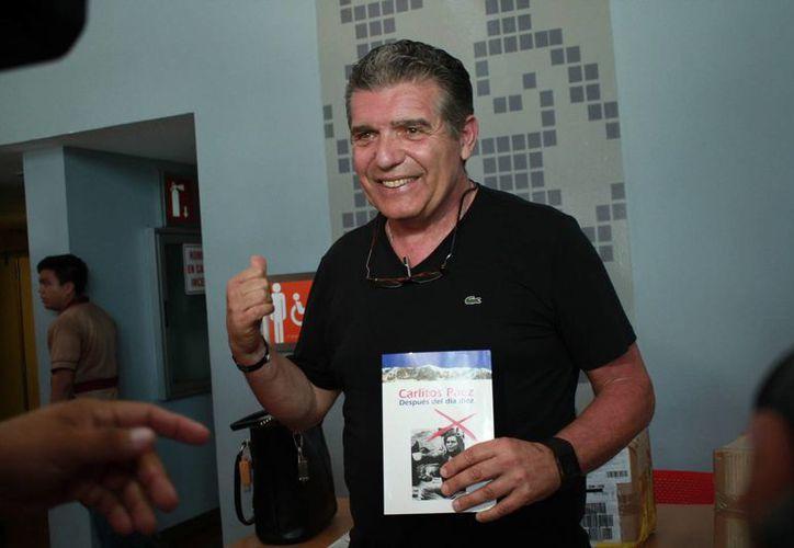 El uruguayo Carlos Páez, una de las 16 personas que sobrevivió al accidente aéreo en Los Andes en 1972, durante la charla motivacional a emprendedores en el concurso 'Guerreros de la Tierra'. (Fotos: Jorge Acosta/SIPSE)