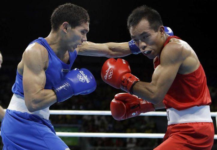 El boxeador Elías Emigdio fue derrotado por el colombiano Ceiber David Ávila, en los Octavos de Final de Río 2016. (Frank Franklin II/AP)